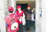 唐山党员志愿者开展慰问老党员和环境整治活动(图)