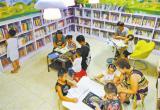 社区图书馆里闻书香(图)